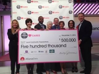 Mindy Grossman, left, and HSN's Bill Brand, right, handing over a pretty big check